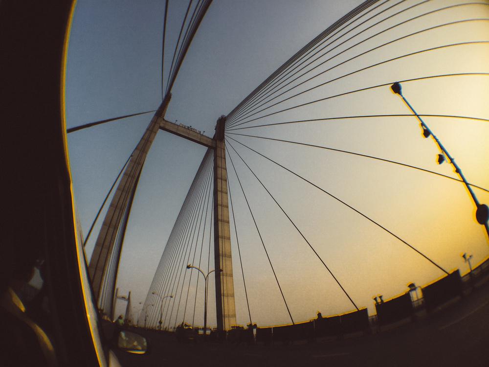 New Howrah Bridge (Vidyasagar Setu), Kolkata. Shot on iPhone 6 with the IMVIO Fisheye lens.