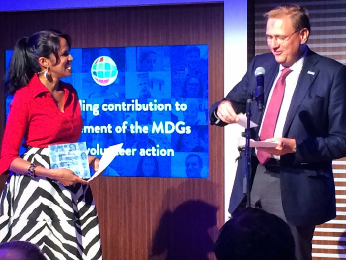 Nadira and Richard Dictus, executive coordinator of the UN Volunteers programme, present at the Peoples' Voices Awards.