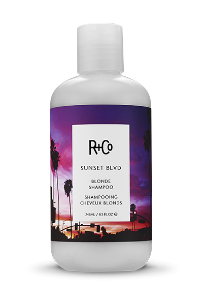 <b> SUNSET BLVD </b></br>Blonde Shampoo<br> <i> Like Photo-Editing For Your Hair.<br>Eliminates Brassy Tones, Makes Blondes Extra Bright and <br>Greys Fantastically Silver </br></i></br> <i> $29.