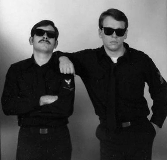 "On the right, as a young photojournalist in the US Navy around 1988.  My cohort George Hammond III is on the left.  We called ourselves ""The News Brothers."""
