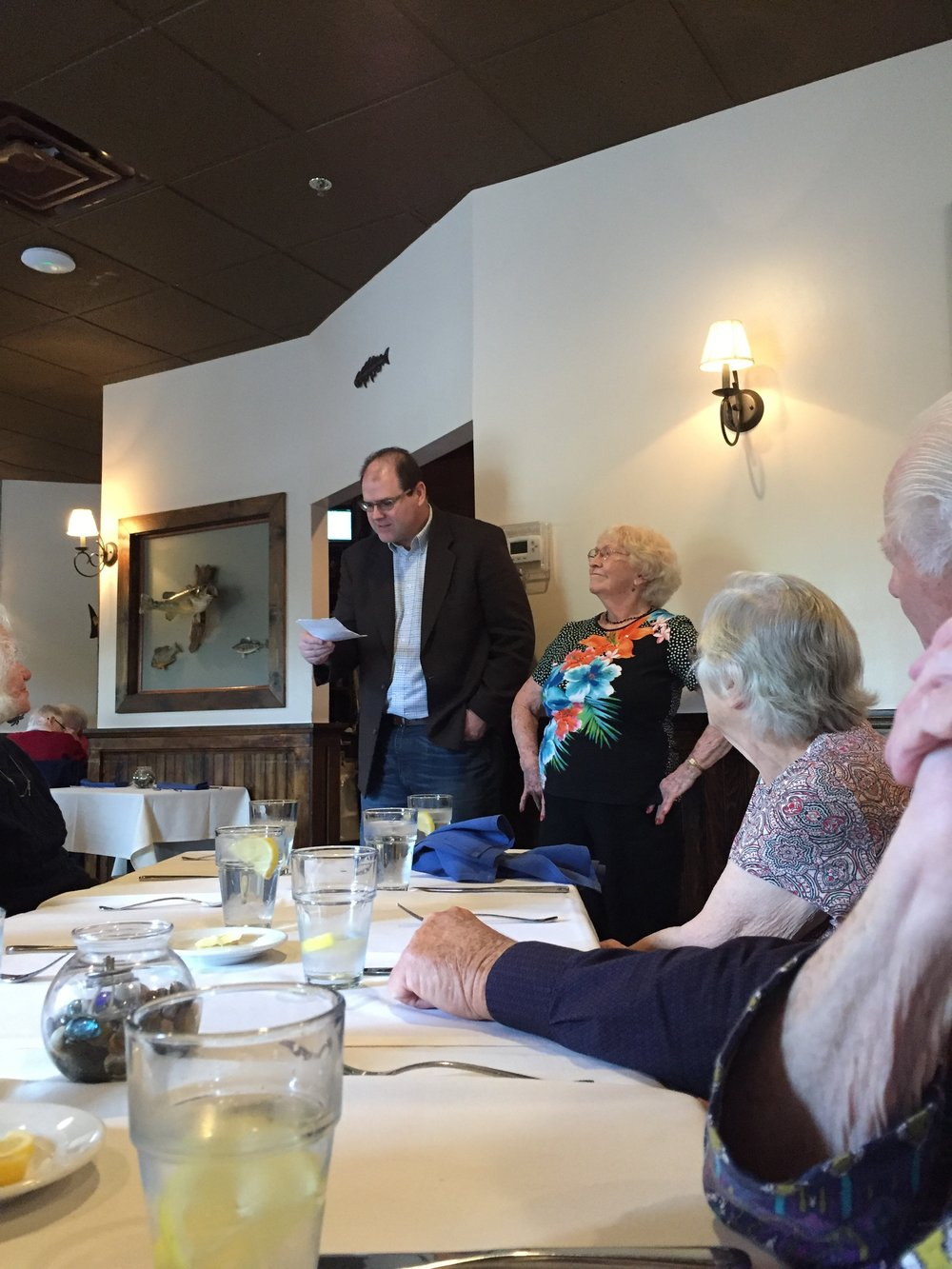 Lunch at Skipjack's and Pastor Harvey reading a poem Marie wrote