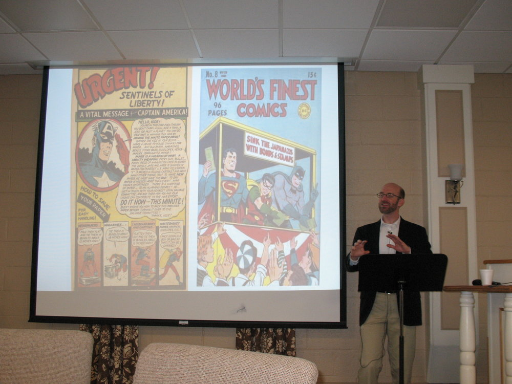 Pastor Knott giving a lecture on American History through the lens of comics