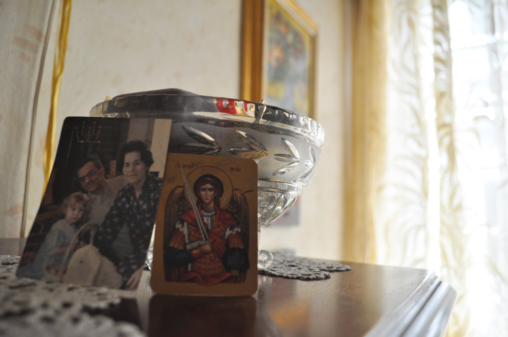 An old photo of my grandmother with my  grandfather, Bozidar, and sister, Simonida, sits next to an Orthodox icon. Belgrade, Serbia.