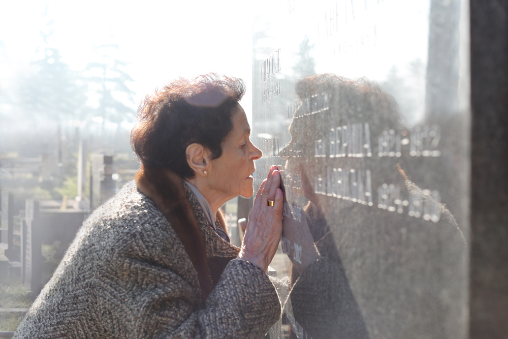 My grandmother Vinka kisses the grave of her brother, Gojko Radovic. Valjavo, Serbia.
