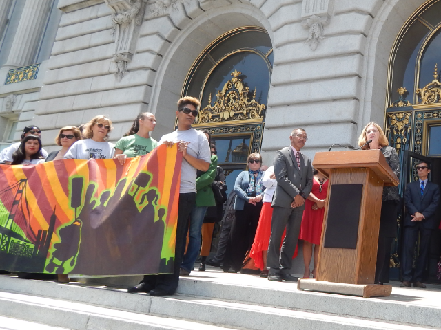 Wu Yee's Chief Executive Officer (right), Monica Walters, speaks on the importance of investing in San Francisco's early childhood education at City Hall on July 8, 2014.