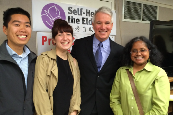 Wu Yee staff members Moony Tong, Lindsay McComb and Isabel Renggenathen pose with San Francisco District Attorney George Gascón (second from right) at Lady Shaw Senior Center on June 10, 2014.
