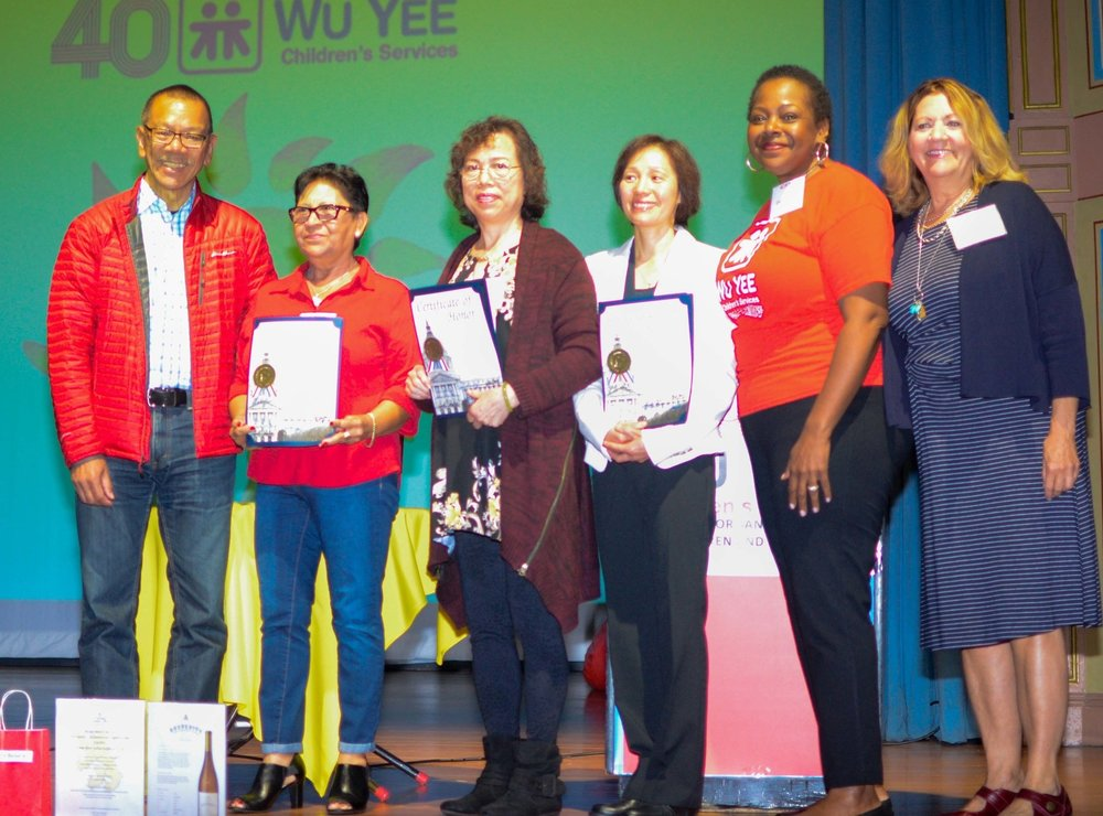 Supervisor Norman Yee with Awardees Delia Suarez, Siu Kam Cheung, and Barbara Ng, Director of Provider Services, Cheryl Hughes and Chief Executive Officer, Monica Waters.