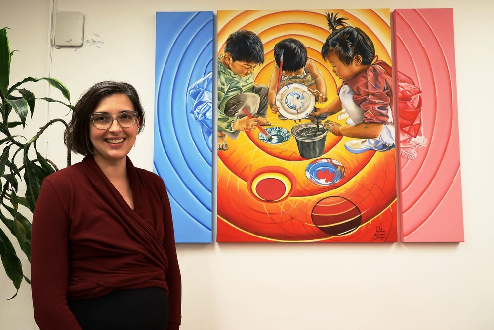 Christine Sarigianis with her painting,  In the Moment of Learning
