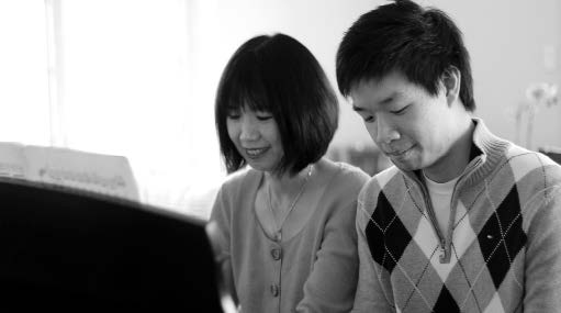 Michelle Chen Kuo and Christopher Kuo of Two Piano Journey practicing piano.
