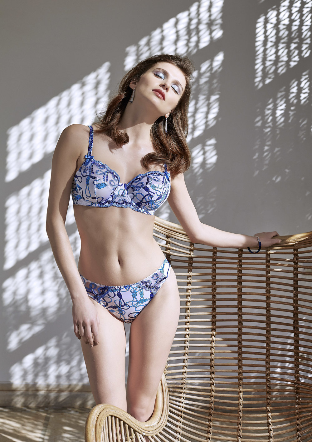 Fuller-figure balconnet, sizes 100 c; 85 to 100 d, e, f : $84 Slip, sizes 38 to 46: $50