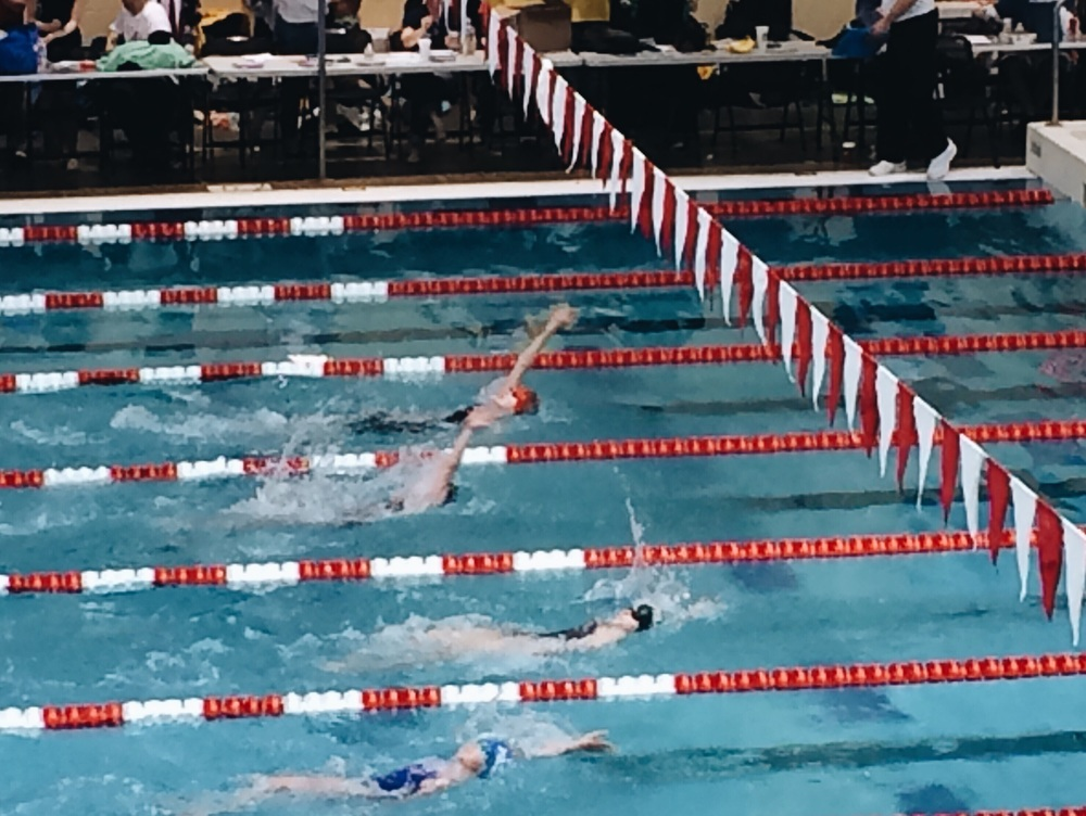 First in her heat at state (red cap & black shortjohn suit)