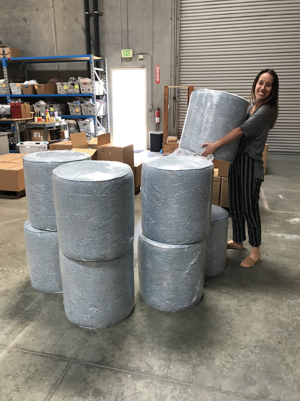 our designer katie helping drop off custom ottomans being used in the office and around the entire space.