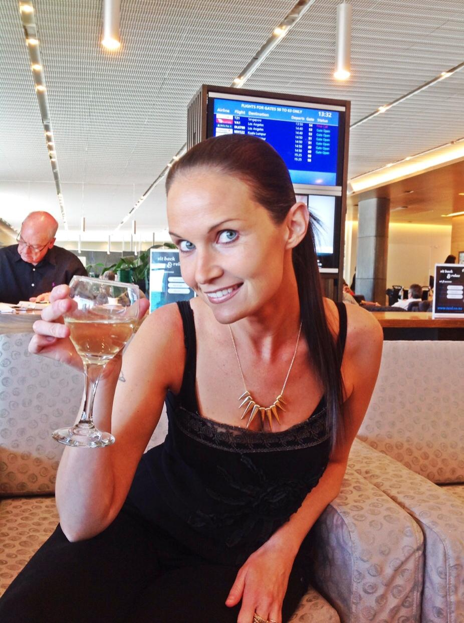 ENJOYING A WINE IN THE BUSINESS KORU LOUNGE- AND LOOKING RATHER AWKWARD IF I DO SAY SO MYSELF!