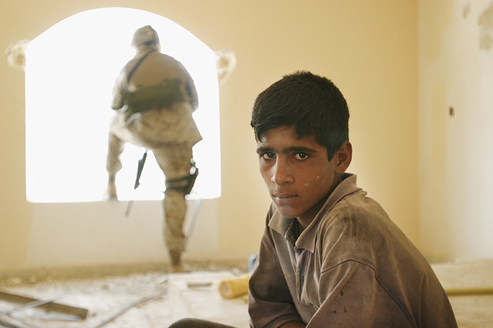 Boy on construction team for birth center funded then defunded by U.S. Army. Marines promised to resume support — if local leaders cooperated. Jurf-al-Sakhar, Iraq, August 8, 2004