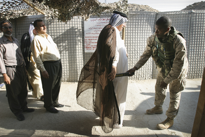 Marine searches local sheikh and Iraqi power plant workers entering FOB Iskan, which encompassed Musayyib power station, August 7, 2004