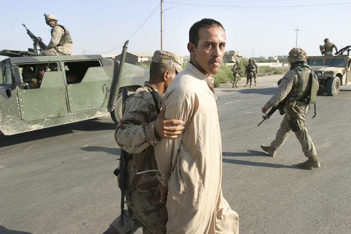 Iraqi man detained by Iraqi soldier after argument, Iskandariyah, Iraq, August 5, 2004