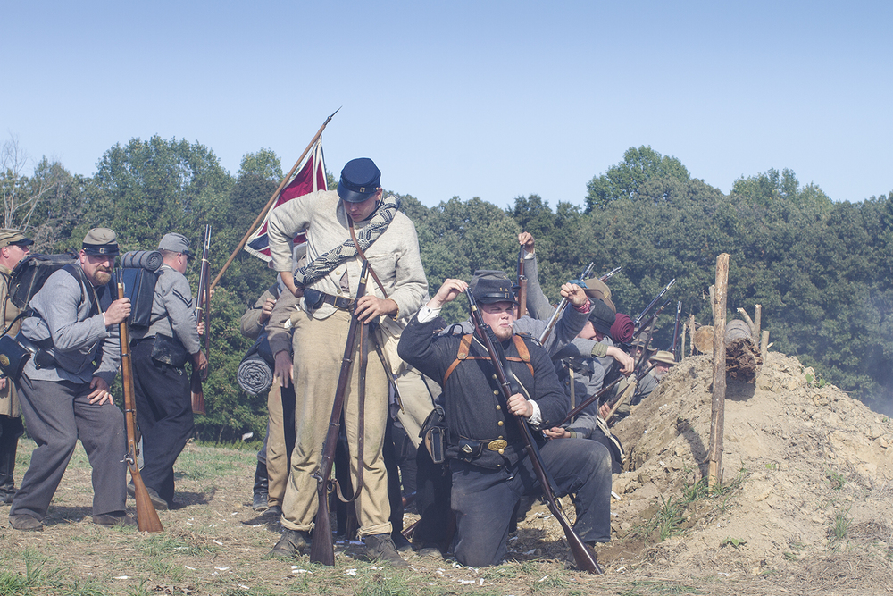 Confederate reenactors fire at Union troops, during a staging of the battle of New Market Heights. Henrico, Co., Virginia, September 2014