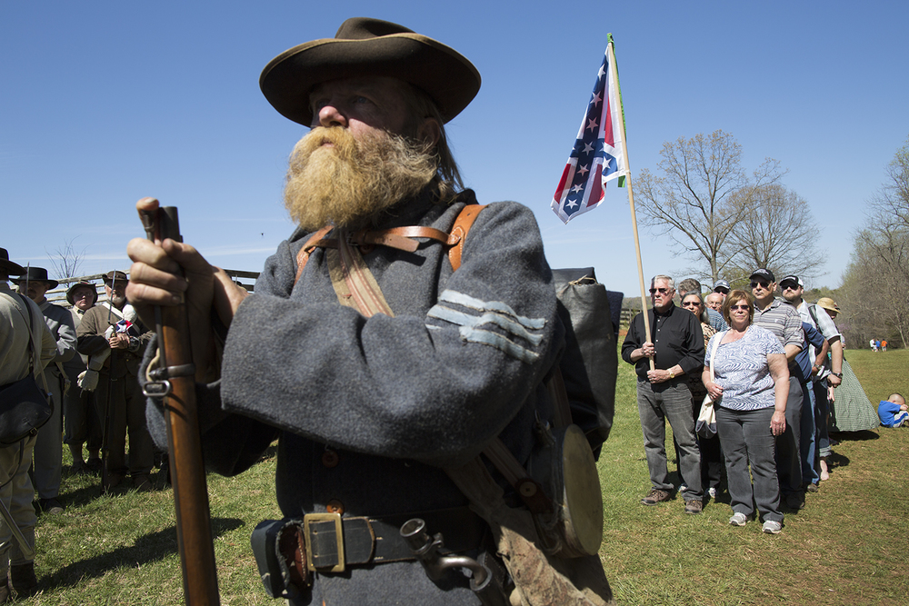 Visitors gather to join a march of Confederate reenactors during ceremonies marking the 150th anniversary of the surrender of the Army of Northern Virginia at Appomattox Court House, VA, 2015.