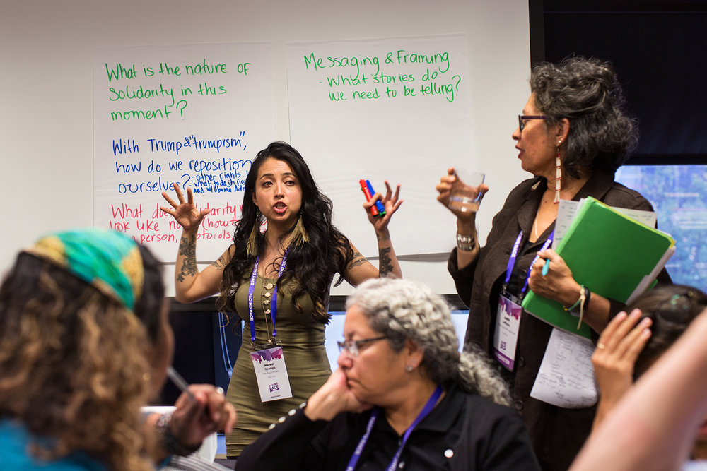 "The  Praxis Project 's Marisol Ocampo speaks and take notes for the group during ""Solidarity with Standing Rock"" breakout session during Facing Race 2016, Atlanta, GA, 11 November"