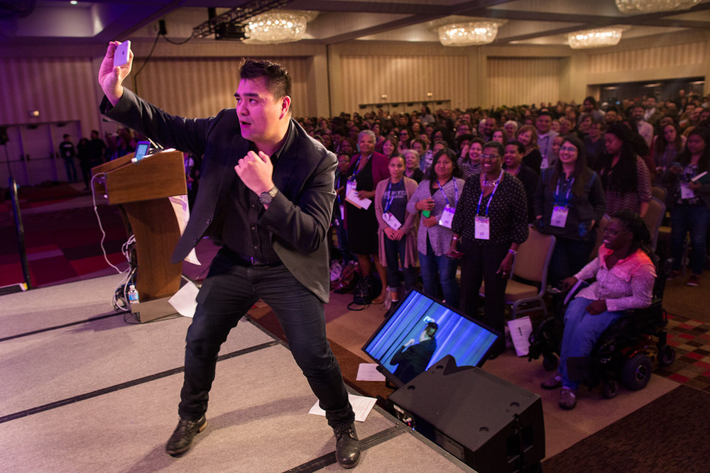 Keynote speaker #2 (of two) Jose Antonio Vargas ( Define American ) takes a selfie with the audience of Facing Race 2016 behind him, Atlanta, GA, 11 November