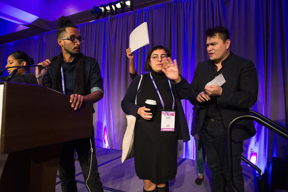 Protesters take the stage to express opposition to keynote speaker Jose Antonio Vargas ( Define American ) at Facing Race 2016, Atlanta, GA, 11 November
