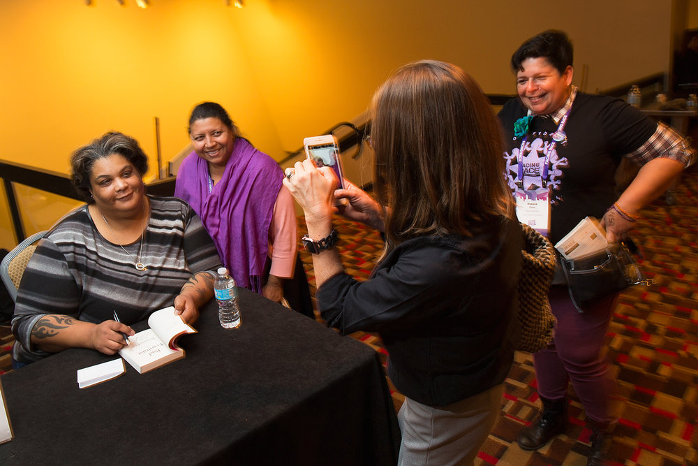 Author  Roxane Gay  signs books after her keynote speech at Facing Race 2016, Atlanta, GA, 11 November