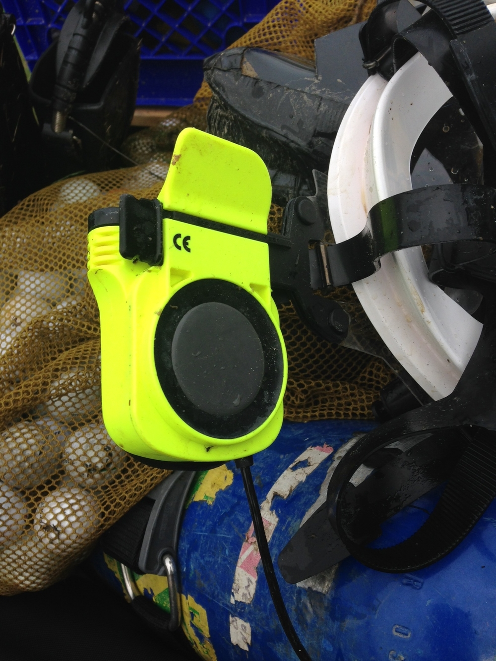 GSM mounted to side of the mask where it rests beside diver's ear