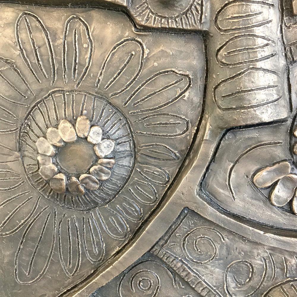 Detail of bronze panel