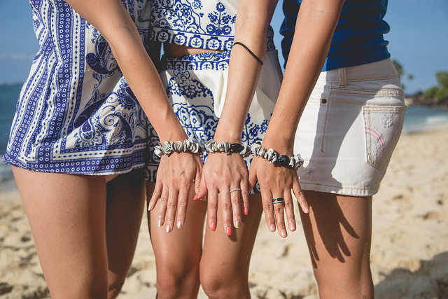 Seashell friendship bracelets and matching blue-white outfits.