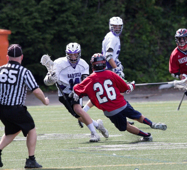 Midfielder Parker Woo '15 dodges a Nathan Hale player in last year's D2 State Championship Game.