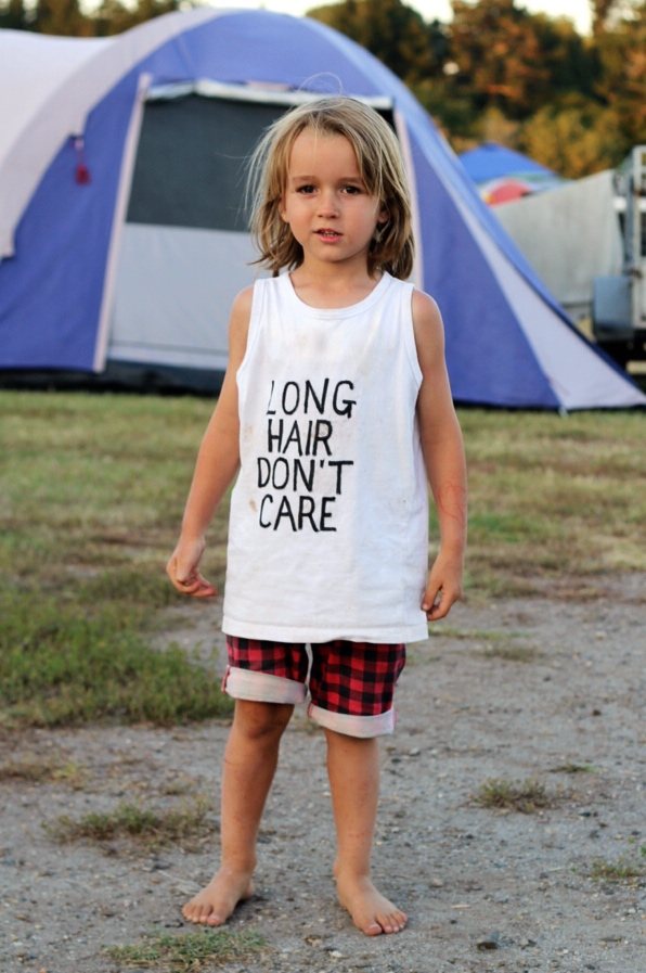 "This is Milo, he is the coolest kid! Loving his tee ""Long Hair Don't Care"" homemade."