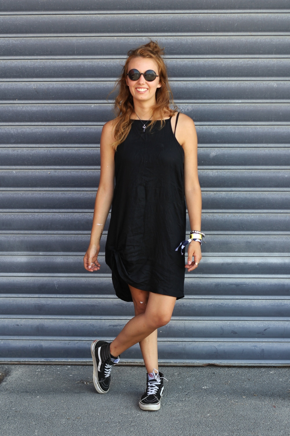 Lily Futyus wearing an Opshop dress, $2 dollar shop sunnies and  Vans .