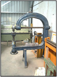 The English wheel is used to shape sheet steel and aluminium in two directions. It can give strength to flat panels, domes, dishes and reverse sweeps to the worked panel. The English wheel takes many years of practice to use it correctly.