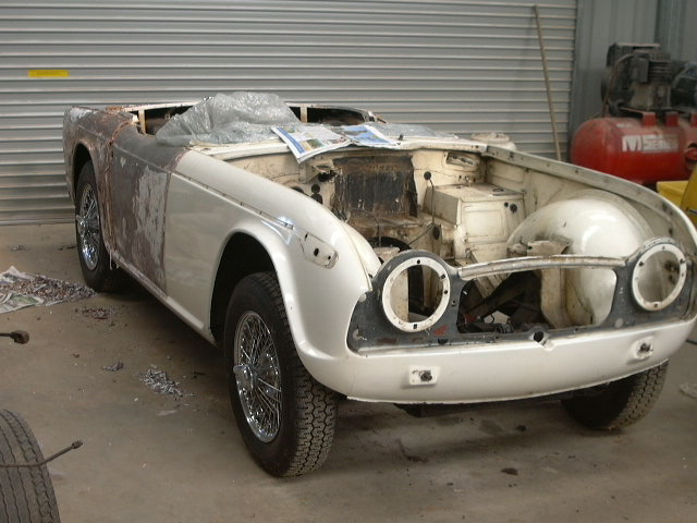 The Triumph TR4a needed a full body restoration. The engine and chassis were cosmetically restored. The front inner guard had some minor accident damage. The door sills were badly rusted and were replaced with two good second hand guards.