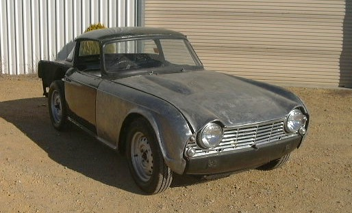 The Tr4 was registered prior to the owner commencing its restoration. The body shell was in very poor condition. The decision was made to locate a good replacement body shell.