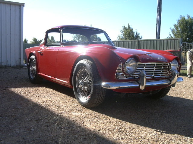 The Tr4 was finish in two pack Signal Red. The new body shell was fitted out with all new rubbers, wire wheels and its original hard top.