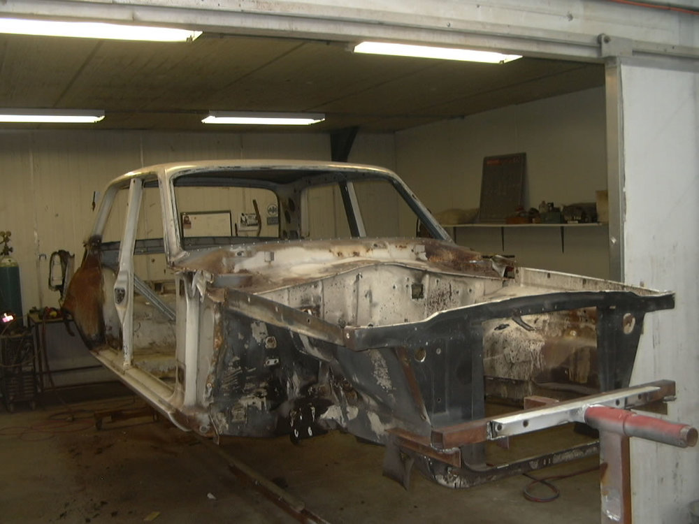 The Valiant has been stripped down to its bare body shell. It has been sandblasted and painted inside every cavity with two pack paint. The rear quarter panels have been removed for repair from accident damage and rust. This also gives further opportunity to coat the hard to reach areas in the boot with paint.