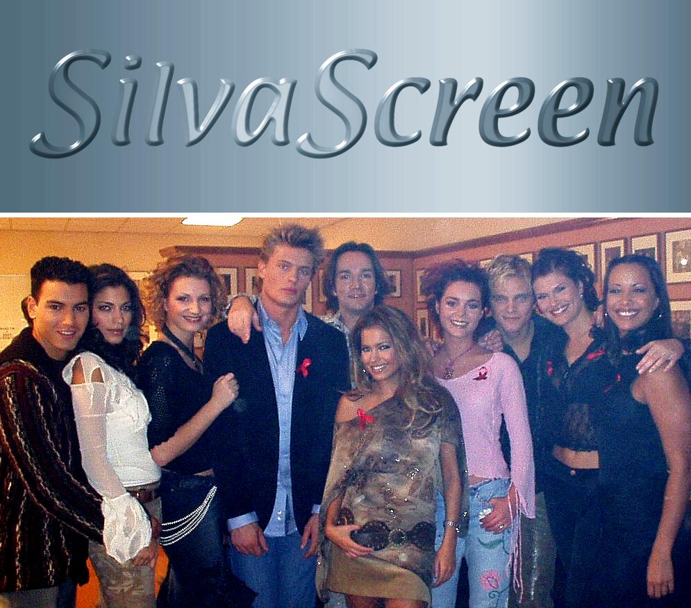 SilvaScreen groepsfoto met (vlnr) Mohammed Chaara, Touriya Haoud, Denise van Rijswijk, Winston Post, Spiros Chalos, Sylvie Meis, Kim-Lian van der Meij, Sander Foppele, Anouk van Nes (gast) en Sonja Silva (2002)