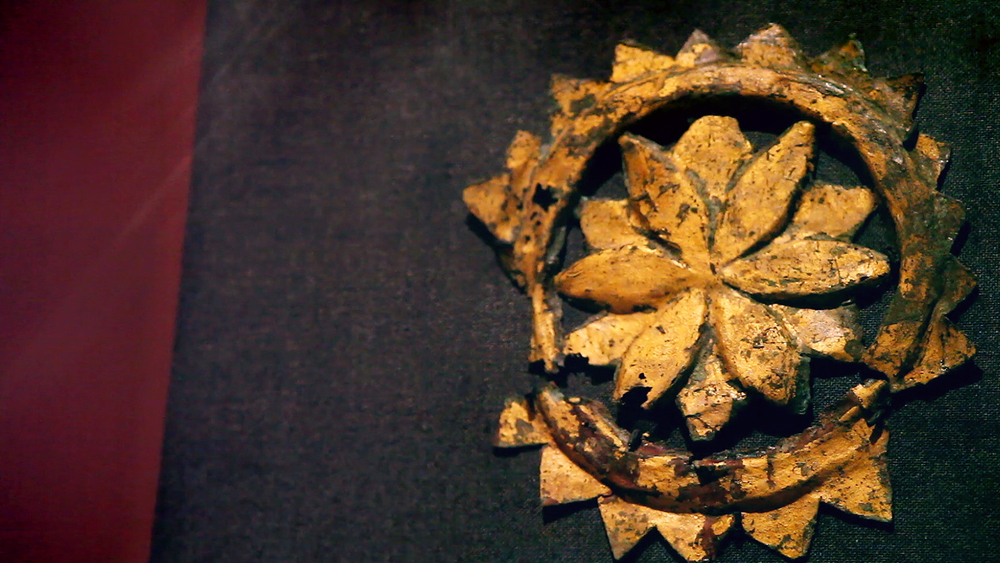 A gold-gilded lotus leaf artifact, discovered at Mes Aynak.