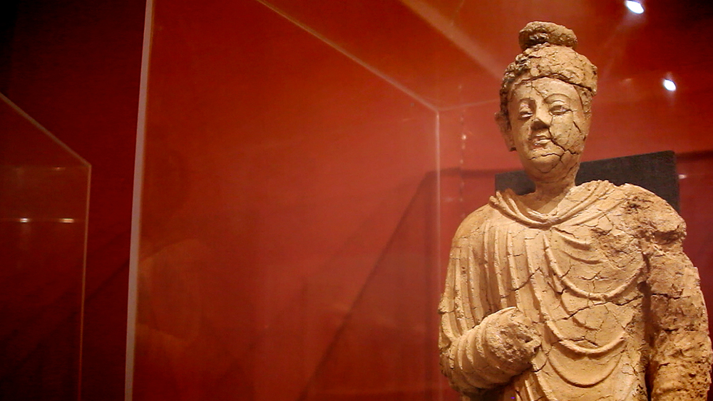 A standing Buddha statue, currently housed at the National Museum of Afghanistan in Kabul.