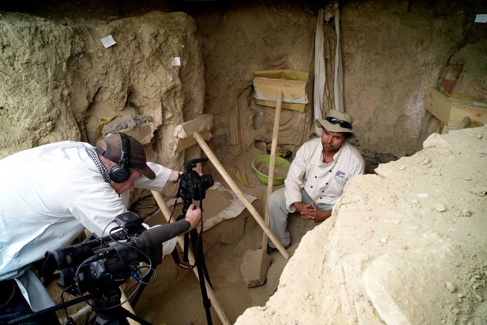 Director Brent E. Huffman preparing to interview archaeologist Qadir Temori.