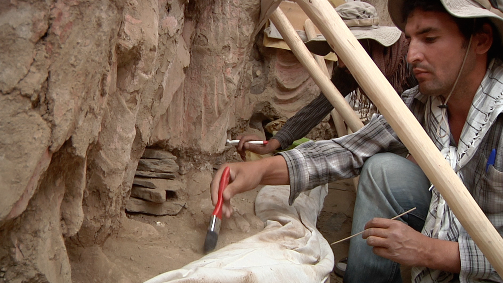 Afghan archaeologists hard at work excavating an artifact.