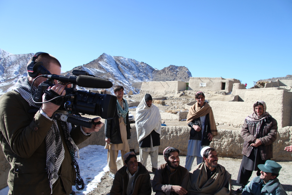 Brent E. Huffman, filming at one of the many villages that will be destroyed due to the mining.