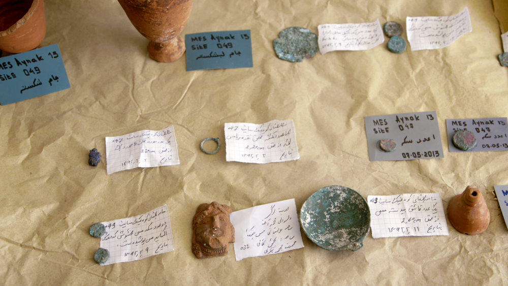 A table of Mes Aynak coins and artifacts.