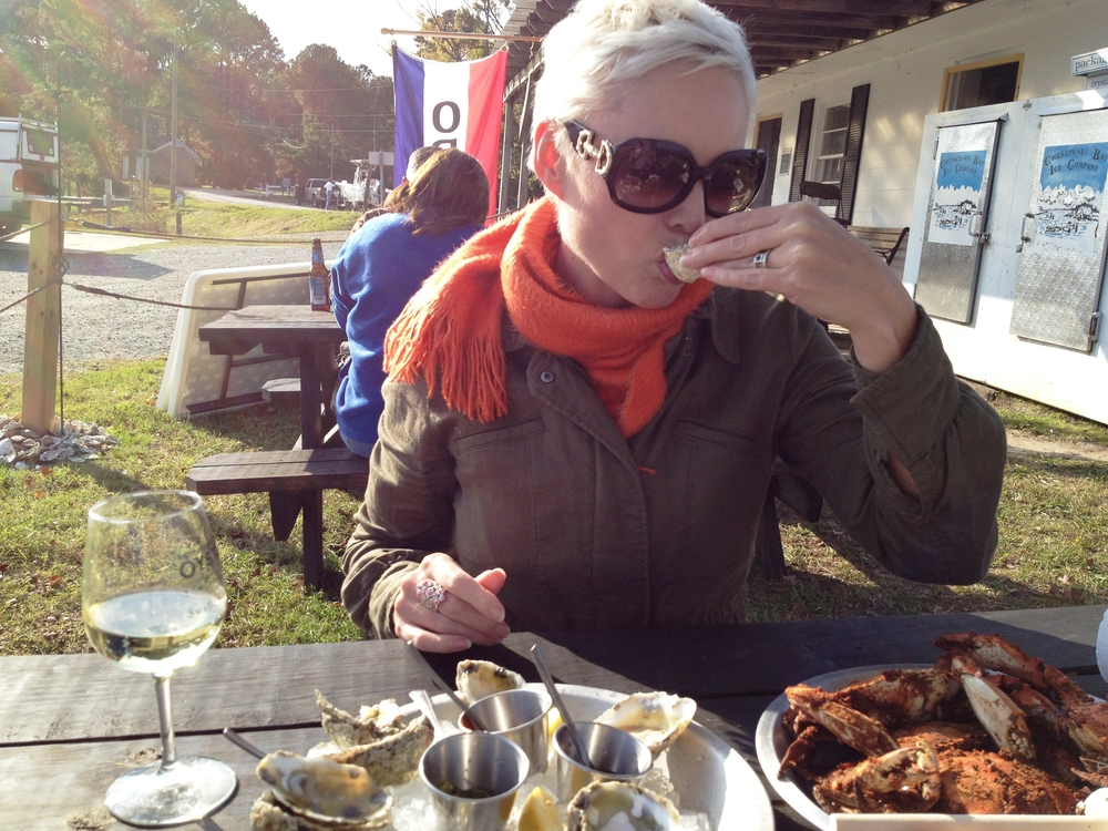 Enjoying oysters, wine and steamed crabs at Merroir Restaurant in Topping, Virginia.