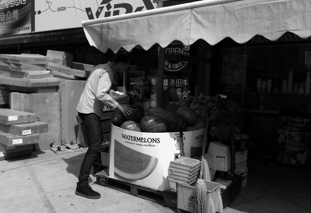 Buying a watermelon in the Lower East Side Manhattan, NY May 2012