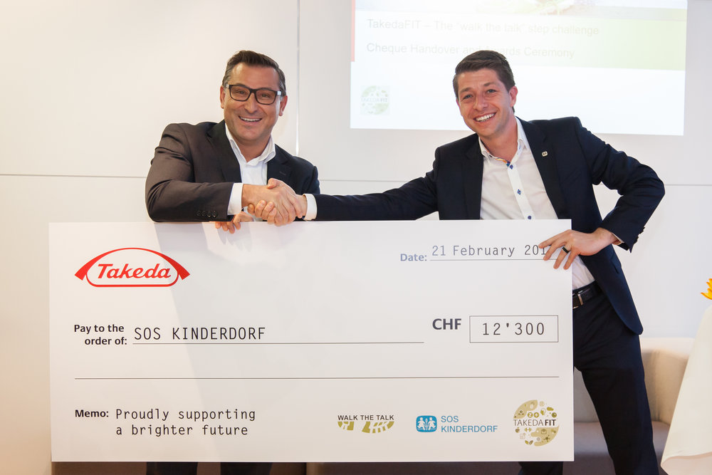 CARROT users in the Takeda walking program competed in teams to meet as many daily CARROT activity goals as possible, with Takeda pledging 12,300 Swiss Francs to the charity selected by the winning team. Pictured is Takeda's Certified Corporate Wellness Specialist and Consultant Selim Cevik presenting the donation to SOS Kinderdorf.