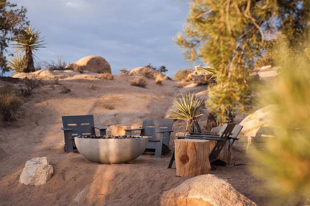 Fire Features - There is nothing quite so sublime as sitting in front of a warm fire in the High Desert while stargazing on a cool evening. The easiest way to provide this  experience to your guests is to offer a propane-fueled fire feature.One of the simplest ways to do this is to take a large, steel Chinese wok, add three short steel legs and a fire ring and — presto — an inexpensive fire feature that invites people to pull up chairs on all sides. We often install  these with flexible hoses and quick-connect  fittings so you can move it to  accommodate other activities.We also offer more elaborate firefeatures, such as ones fashioned around a gabbion — a wire cage filled with rocks.