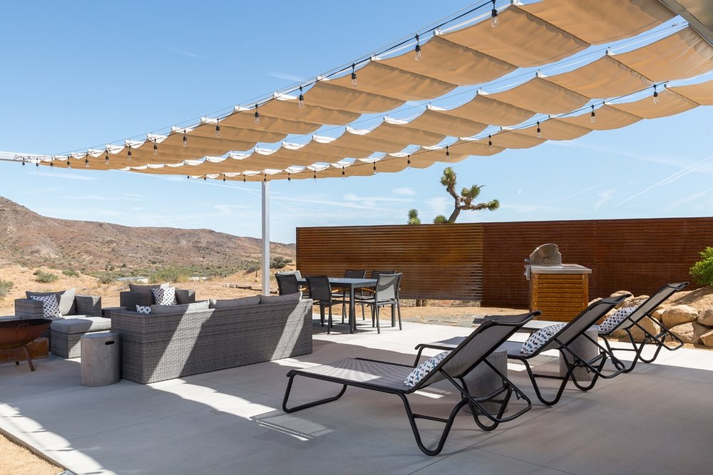 Retractable Patio Shade Structures - In the High Desert, summers are plenty warm and winters cool.  That poses  a challenge for patios. In the summer, guests want ample shade so they can  avoid direct sun. In the winter, they want all the sun they can find.We solve this dilemma by offering a variety of retractable shade structures, most often utilizing shade cloth materials.