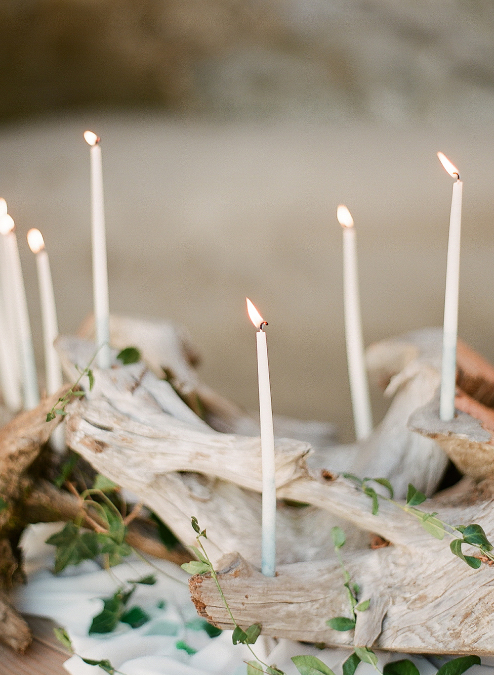 a driftwood centerpiece with dip-dyed indigo skinny taper candles during this oregon coast wedding photographed by Destination Wedding Photographer Lexia Frank -a film photographer in portland oregon. TOP DESTINATION WEDDING PHOTOGRAPHY, OREGON COAST WEDDING, WWW DOT LEXIA FRANK DOT COM